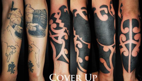 Copertura su braccio con un tatuaggio tribale