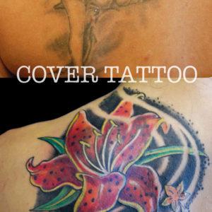 Copertura di un vecchio tatuaggio con 2 pesci e un fiore